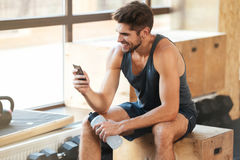 Athletic man sits on the box royalty free stock image
