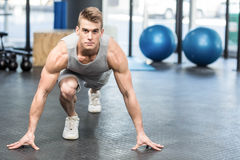 Athletic man smiling to camera. At crossfit gym Royalty Free Stock Images