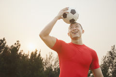 Athletic Man with Soccer Ball Stock Image