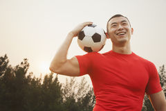Athletic Man with Soccer Ball Royalty Free Stock Photos