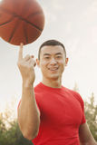 Athletic Man Spinning Basketball and Looking at Camera Stock Images