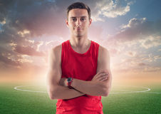 Athletic man, sportsman on background green Stock Photo