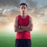 Athletic man, sportsman on background green Royalty Free Stock Images