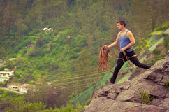 Athletic man standing on cliff with rope in hands Royalty Free Stock Photography