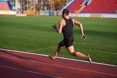 Athletic man start Stock Photography