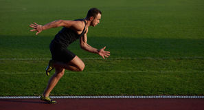 Athletic man start Stock Photo