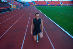 Athletic man start Stock Photos