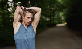 Athletic Man Stretching Arms Behind his Head Royalty Free Stock Image
