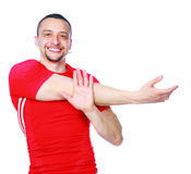 Athletic man stretching the arms. Isolated over a white background Stock Photos