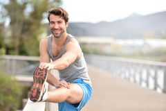 Athletic man stretching out after jogging Royalty Free Stock Photography