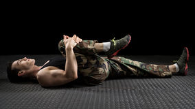 Athletic Man Stretching Stock Photo