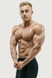 Athletic man with strong abs and core muscles. Shot of healthy power shirtless young athletic man with strong abs and core muscles. Perfect fit, six pack, abs Stock Images