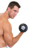 Athletic man with strong biceps rising dumbbell. Isolated on white Royalty Free Stock Image