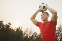 Athletic Man Throwing Soccer Ball Stock Image