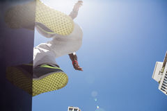 Athletic man about to do a back flip Stock Images