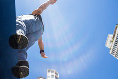 Athletic man about to do a back flip Royalty Free Stock Photography
