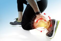 Athletic man touching foot due to sprain with VR medical scannin. Runner sportsman holding ankle in pain with Broken twisted joint running sport injury and Royalty Free Stock Images