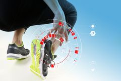 Athletic man touching foot due to sprain with VR medical scannin. Runner sportsman holding ankle in pain with Broken twisted joint running sport injury and Royalty Free Stock Image