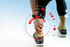 Athletic man touching foot due to sprain with VR medical scannin. Runner sportsman holding ankle in pain with Broken twisted joint running sport injury and Stock Images