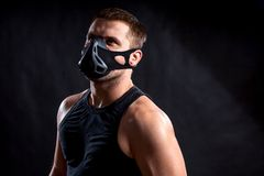 Athletic man in training mask Royalty Free Stock Photos