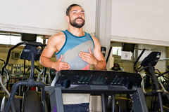 Athletic man on a treadmill Royalty Free Stock Photography