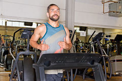 Athletic man on a treadmill Royalty Free Stock Photo
