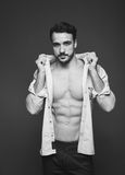 Athletic man with unbuttoned shirt, black and white royalty free stock image
