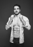 Athletic man with unbuttoned shirt, black and white Stock Photo