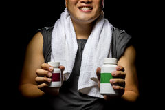 Athletic Man Using Supplements Stock Photos