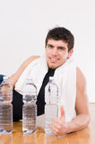 Athletic man with water bottles Stock Photos
