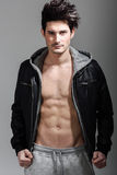 Athletic man wearing hoodie jacket. Studio shot Royalty Free Stock Image