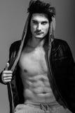 Athletic man wearing hoodie jacket. Studio shot Royalty Free Stock Photo