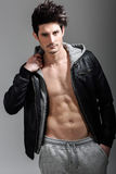 Athletic man wearing hoodie jacket. Studio shot Stock Photo