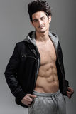 Athletic man wearing hoodie jacket. Studio shot Royalty Free Stock Photos