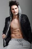 Athletic man wearing hoodie jacket. Studio shot Royalty Free Stock Photography