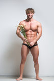Athletic man with a withered flowers Stock Photos