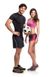 Athletic man and woman with ball on the white background Stock Photo