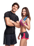 Athletic man and woman with bottle of water on the white Stock Photo