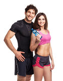 Athletic man and woman with bottle of water on the white. Athletic men and women with bottle of water on the white background royalty free stock photo
