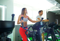 Athletic man and woman doing cardio training program in fitness Stock Photo
