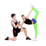 Athletic man and woman doing fitness exercise Stock Photos