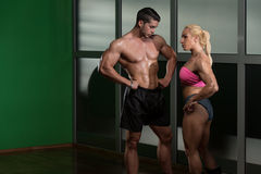 Athletic Man And Woman Doing Fitness Exercise stock images