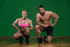 Athletic Man And Woman Doing Fitness Exercise stock photography