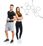 Athletic man and woman with dumbbells with the chemical formula. Athletic men and women with dumbbells on the white with the chemical formula on background royalty free stock photography
