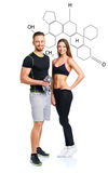 Athletic man and woman with dumbbells with the chemical formula. Athletic men and women with dumbbells on the white with the chemical formula on background royalty free stock photos