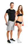 Athletic man and woman with dumbbells on the white. Athletic men and women with dumbbells on the white background royalty free stock image
