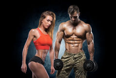 Athletic man and woman. Fitness couple. Man and women on a dark background. Fitness couple stock photos