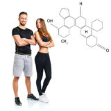 Athletic man and woman after fitness exercise with the chemical. Athletic men and women after fitness exercise on the white with the chemical formula on royalty free stock photography
