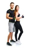 Athletic man and woman after fitness exercise with a finger up o. Athletic men and women after fitness exercise with a finger up on the white background stock photo