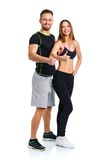 Athletic man and woman after fitness exercise with a finger up o. Athletic men and women after fitness exercise with a finger up on the white background royalty free stock photos
